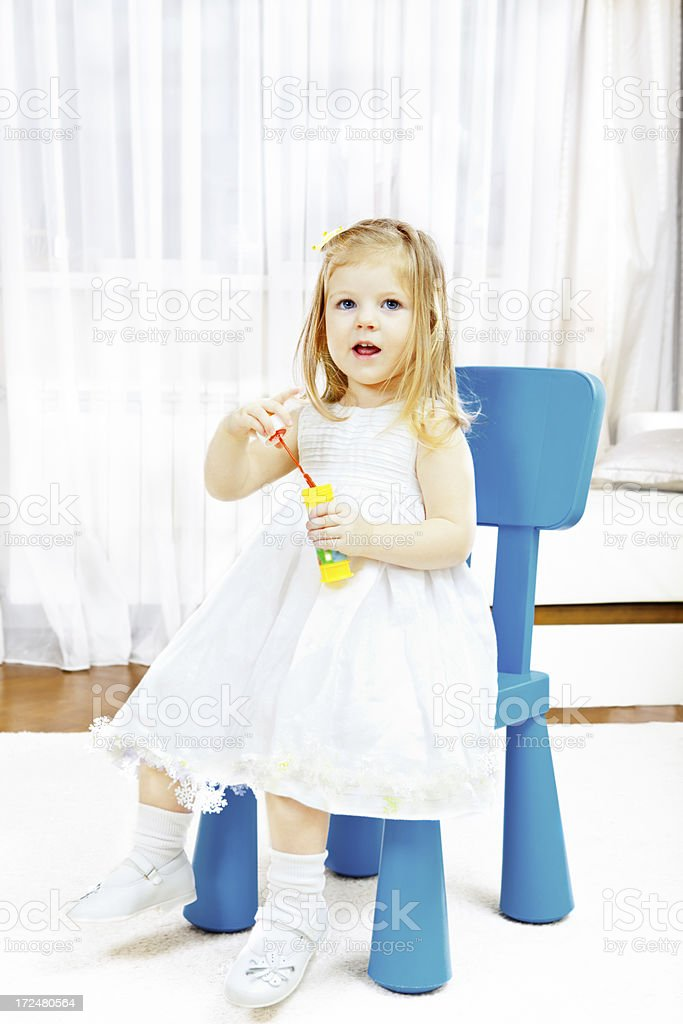 Small Child Blowing Bubbles royalty-free stock photo