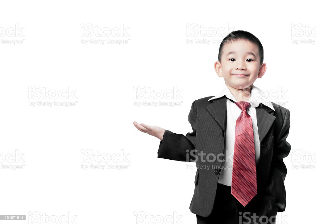 Small child dressed as businessman with hand held palm up royalty-free stock photo