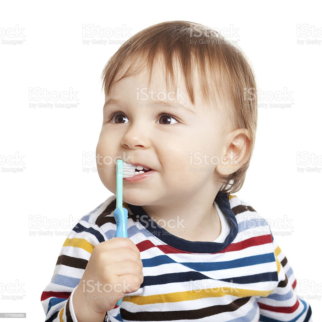 Small child holding toothbrush and brushing teeth royalty-free stock photo