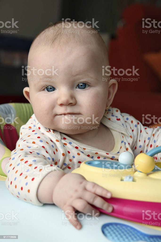 Small child in baby walker stock photo