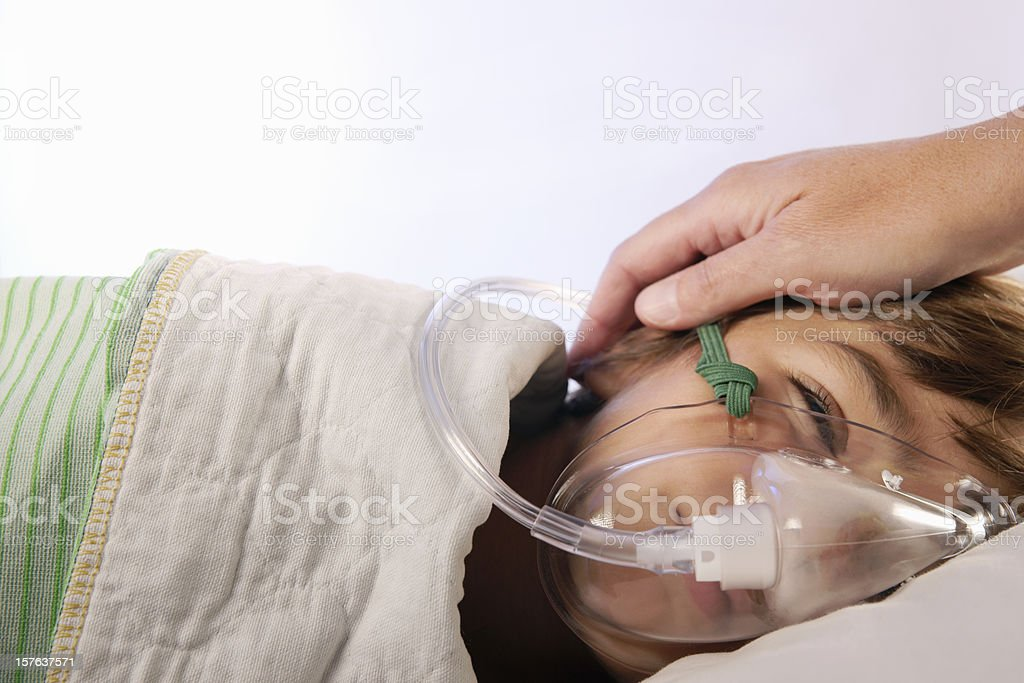 Small child in hospital with a respirator stock photo