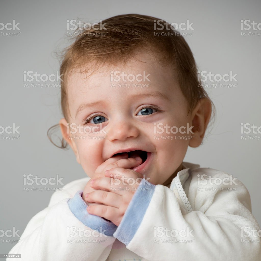 Small child laughing, looking at the camera stock photo
