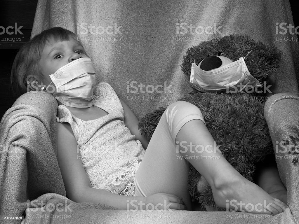 Small child with a toy bear cub stock photo