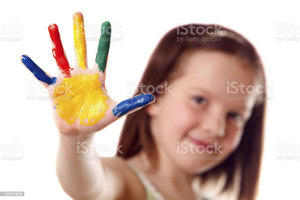 A small child with paint on her hand stock photo
