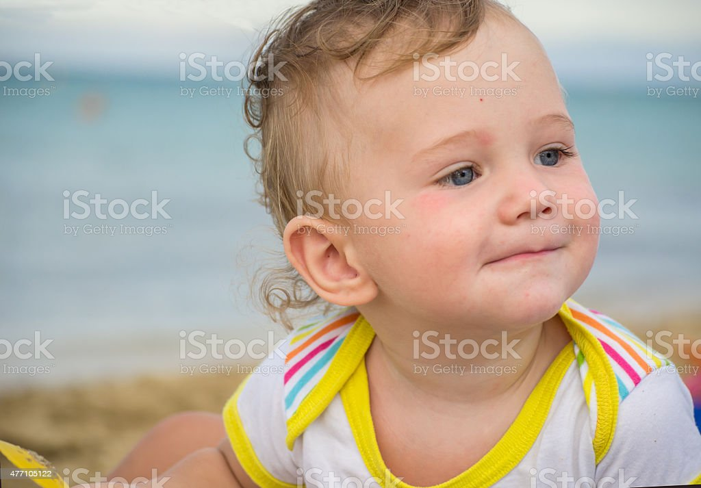 Small child with redness on the skin from food allergies stock photo