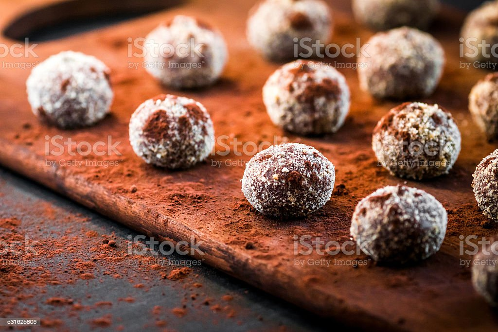 Small chocolate cakes on a cutting board stock photo