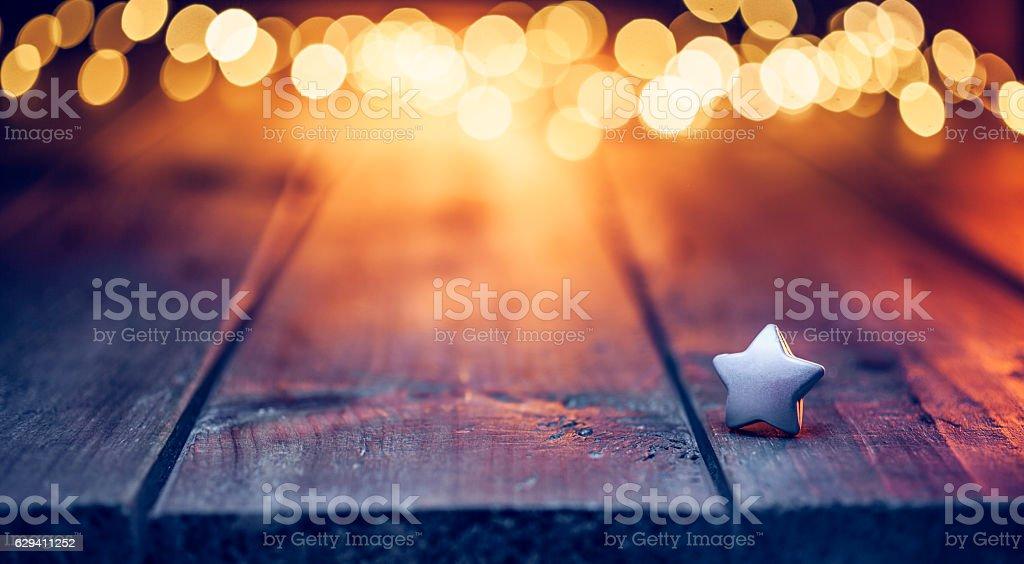 Small Christmas star on old table - Defocused Blue wood stock photo