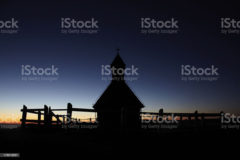 Small church with sunrise background stock photo