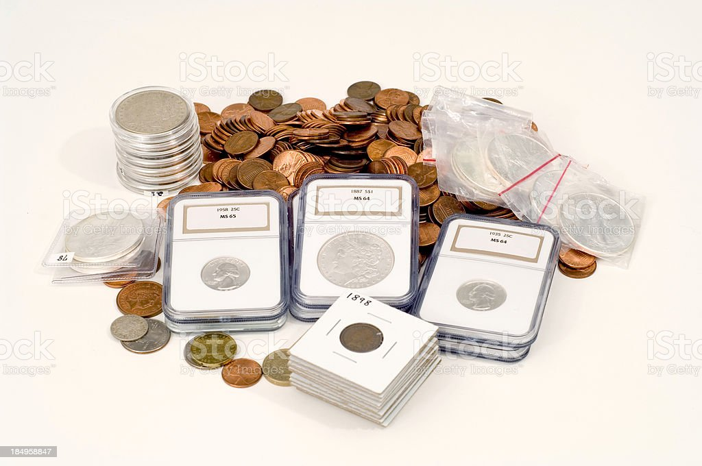 Small coin collection with slabbed coins stock photo