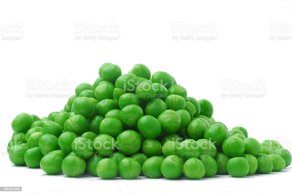 A small collection of green peas with a white background stock photo
