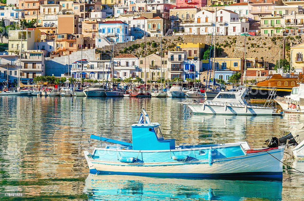 Small colorful fishermen's boat in cosy Greek Port stock photo