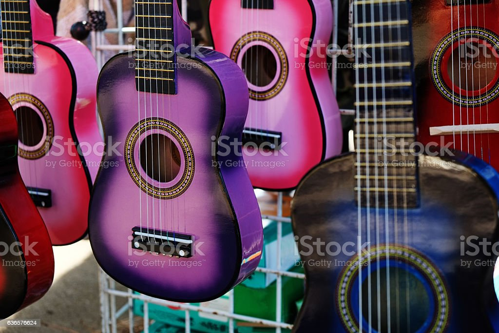 Small Colorful Guitars on Display for Sale stock photo