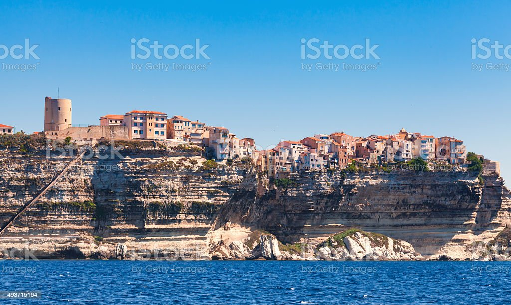 Small colorful houses and fortress tower, Corsica stock photo
