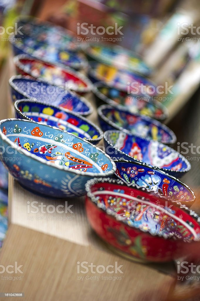 Small colorful pottery bowls in a row royalty-free stock photo