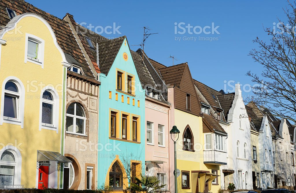 Small colorful townhouses in a row stock photo