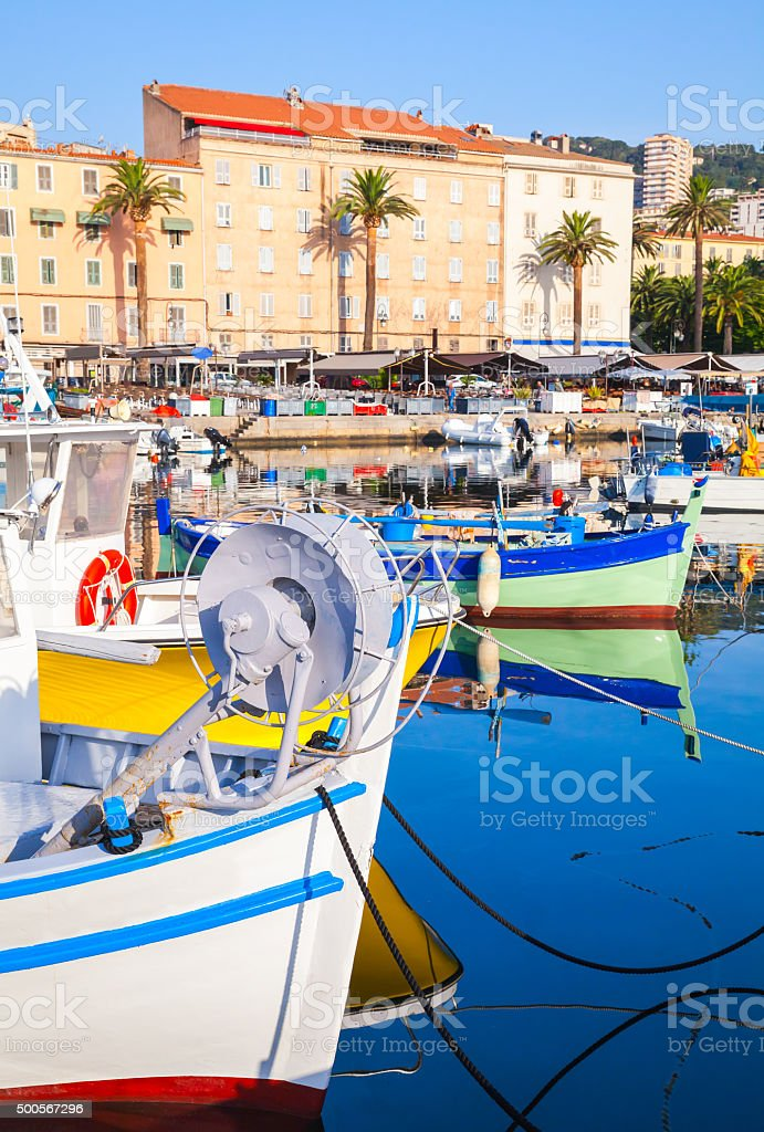 Small colorful wooden fishing boats in Ajaccio stock photo
