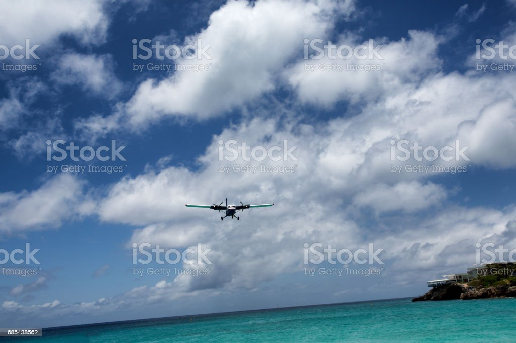 Small Commercial Plane Landing Over Beach stock photo