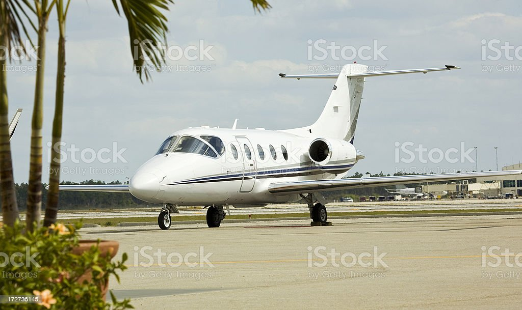 Small Corporate Jet Parked at Airport in Florida royalty-free stock photo