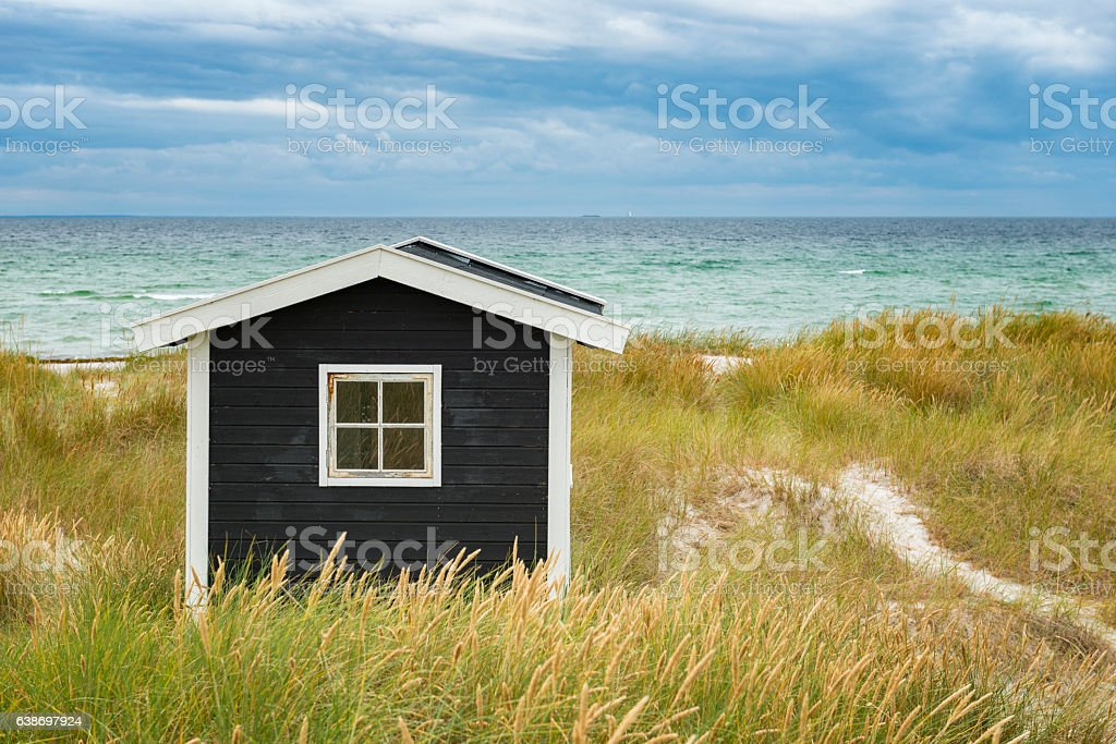 Small cottage at the beach stock photo