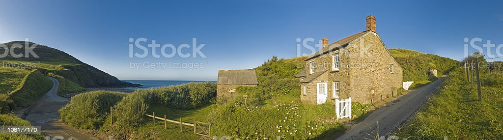 Small Cottage on Sandy Cove Near Ocean royalty-free stock photo