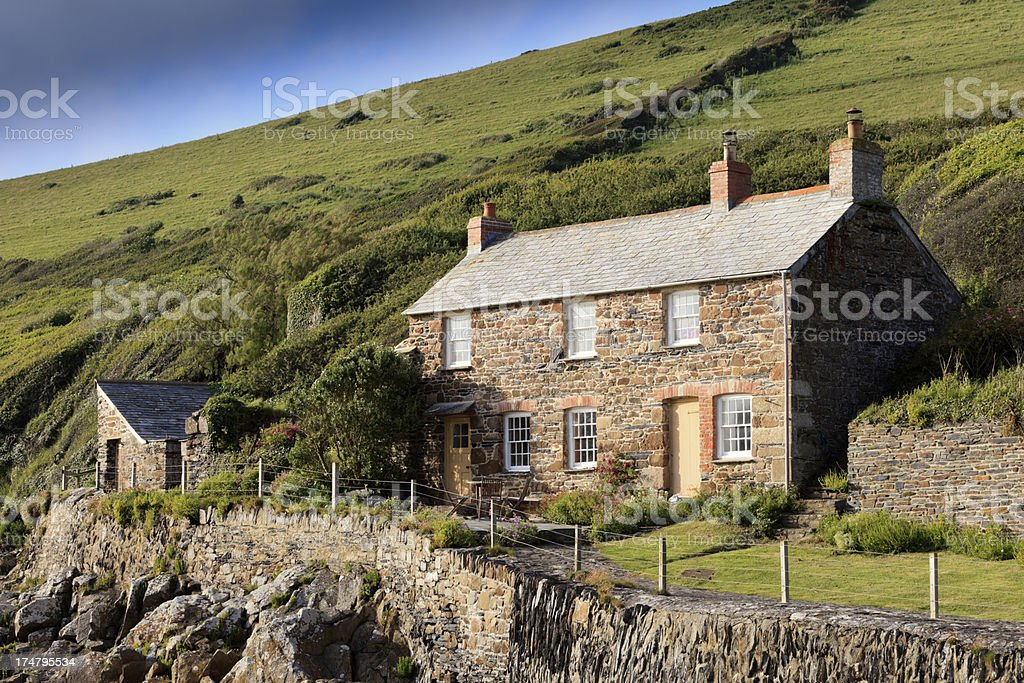 small cottage on the cliffs at Port Quin stock photo