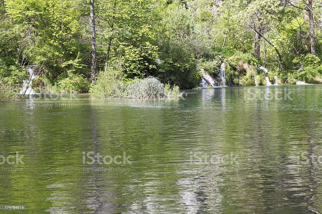 small creeks with streaming cascades into green lake  Plitvice Croatia royalty-free stock photo