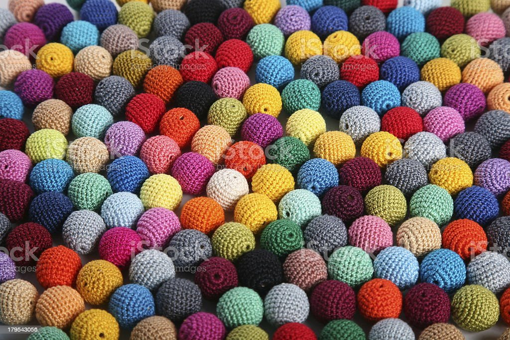 Small crocheted beads balls on the table royalty-free stock photo