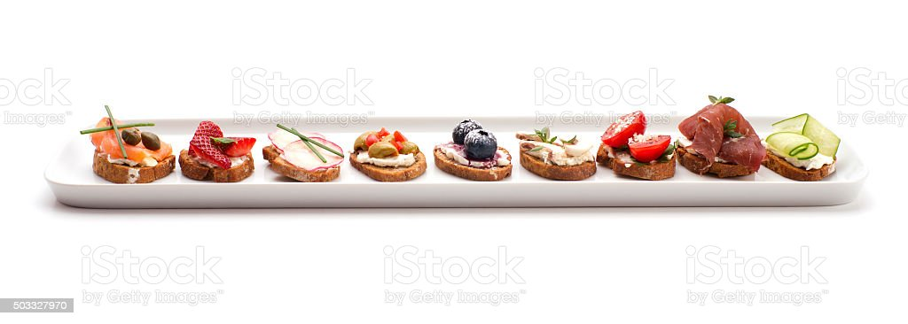 small crostini dish isolated on white stock photo