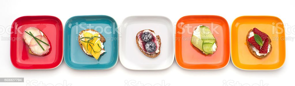 small crostini dishes isolated on white stock photo
