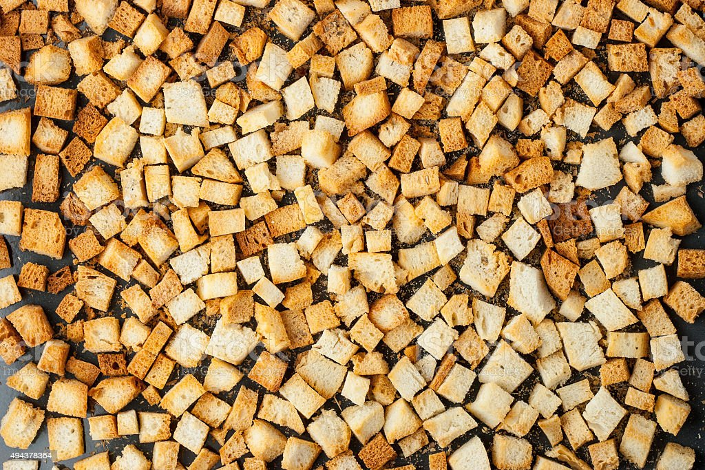 Small croutons on a baking tray top view stock photo
