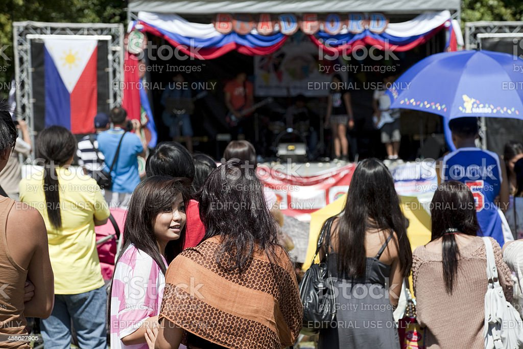 Small crowd watching open-air concert royalty-free stock photo