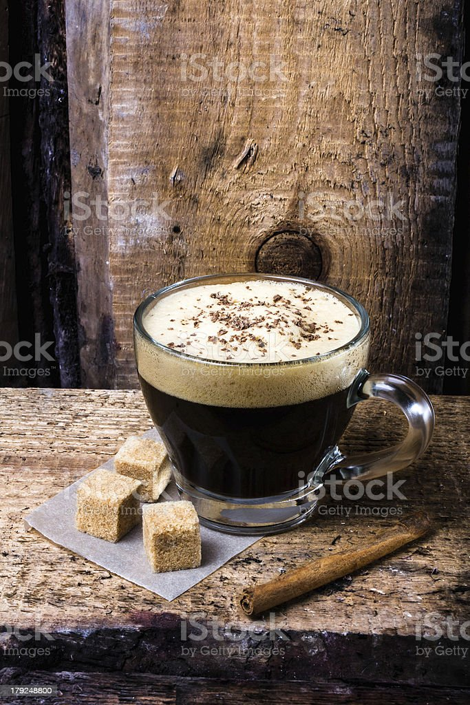 Small cup of espresso coffee in glass royalty-free stock photo