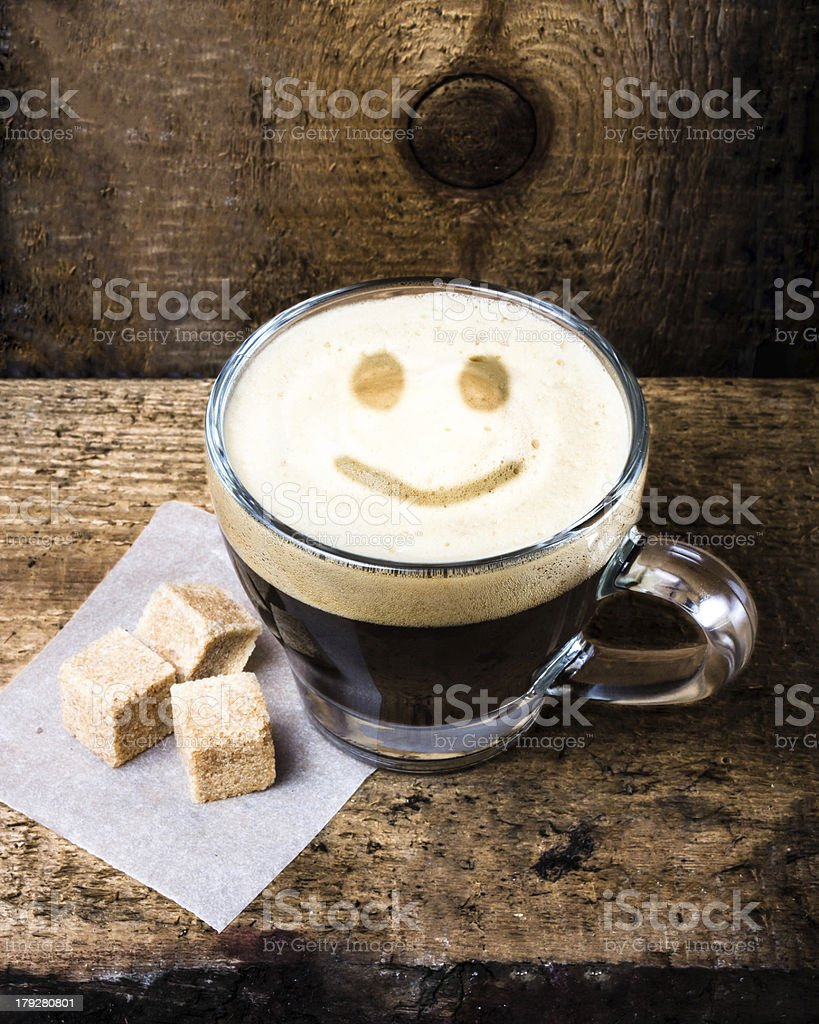Small cup of espresso coffee in glass with smile pattern royalty-free stock photo