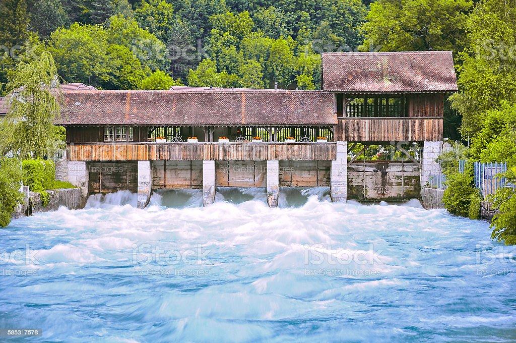 Small dam and wooden bridge. stock photo