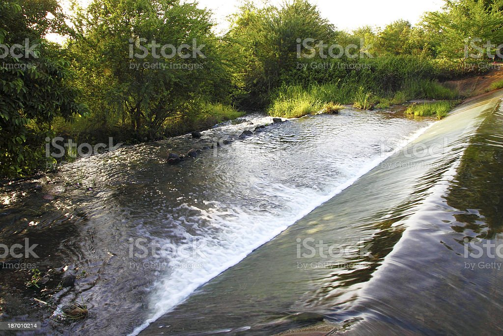 small dam in country side stock photo