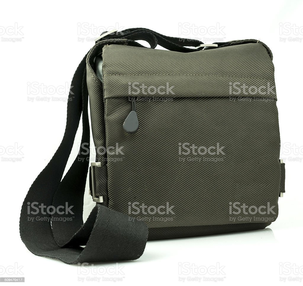 Small dark green sling bag on white background stock photo