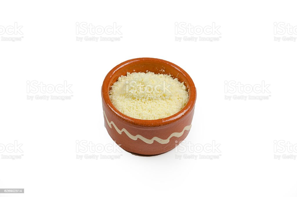 Small decorative bowl with grated cheese on a white background stock photo