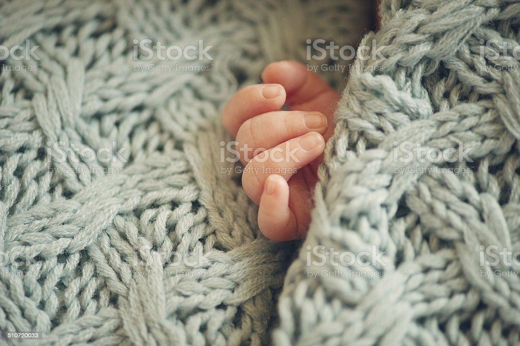 Small delicate little hand of newborn stock photo