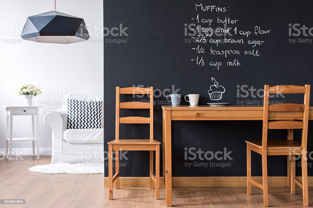 Small minimalist dining room with modern blackboard wall