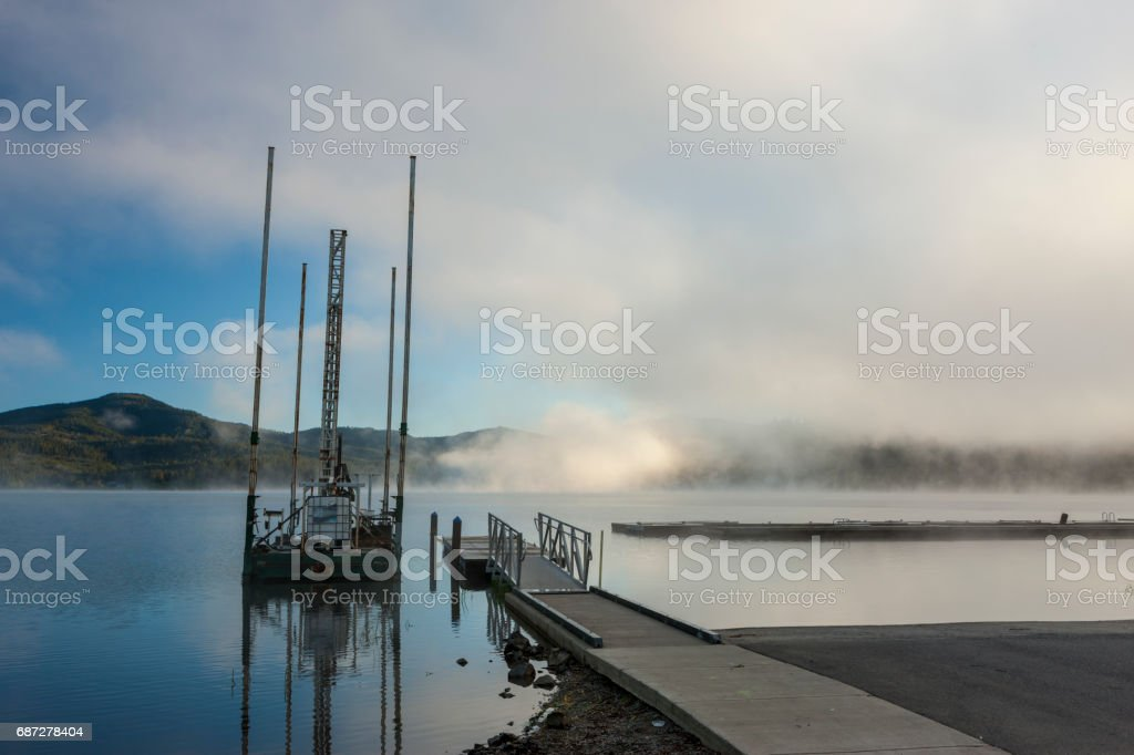 Small dock and barge by lake. stock photo