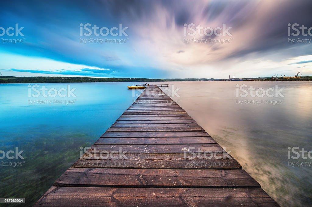 Small Dock and Boat at the lake stock photo