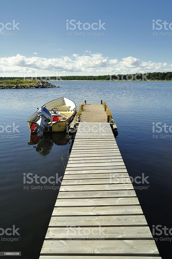 Small Dock and Boat royalty-free stock photo