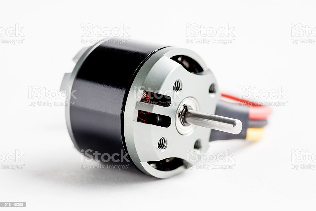 Small electric motor on white stock photo