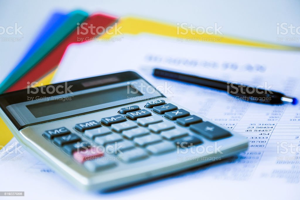 Small electronic calculator on business plan stock photo