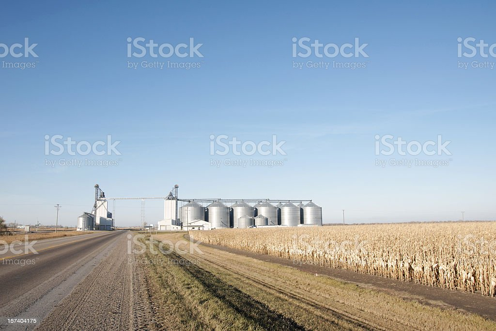 Small Elevator Complex Standing in Field Near Highway royalty-free stock photo