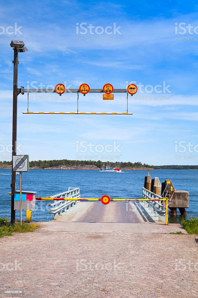 Small empty ferry terminal with metal ramp stock photo