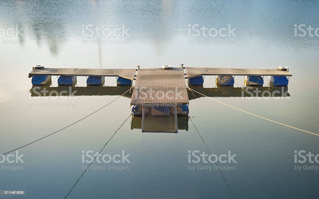 Small empty pontoon bridge in the water stock photo