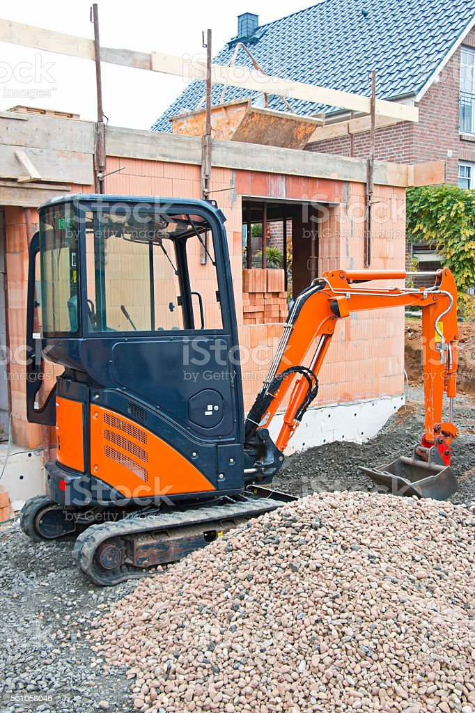 Small Excavator at Construction Site stock photo