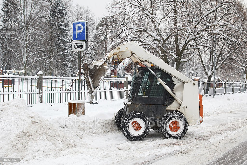 small excavator bobcat working on the street royalty-free stock photo