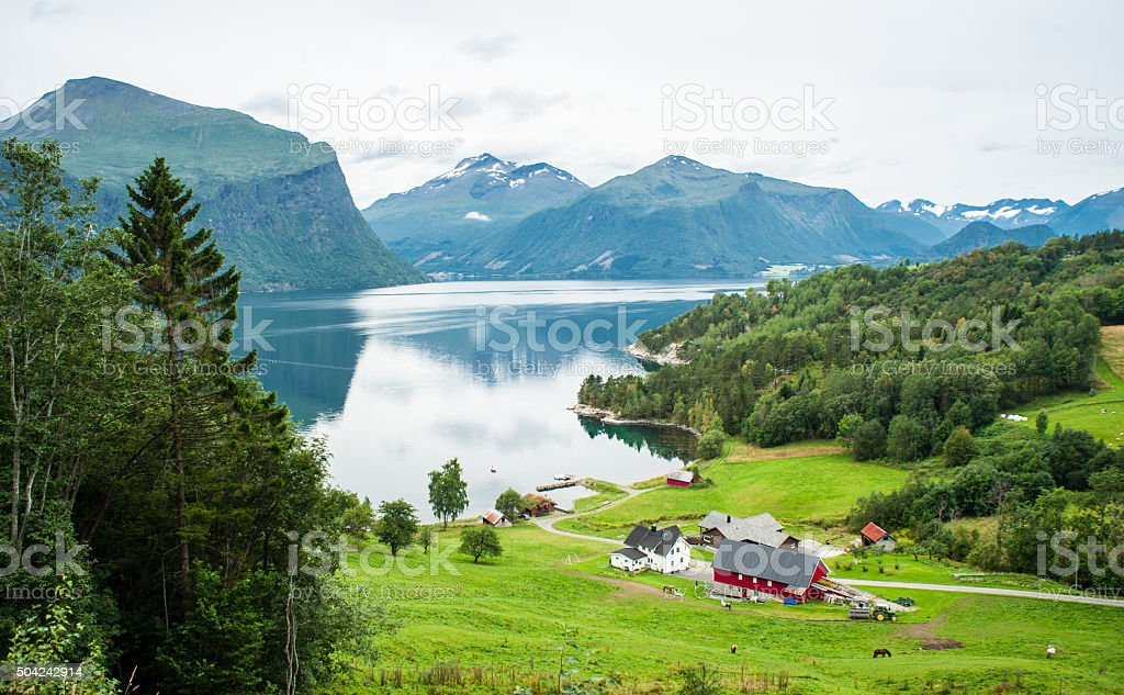 Small farm with red barn in the Norwegian countryside stock photo